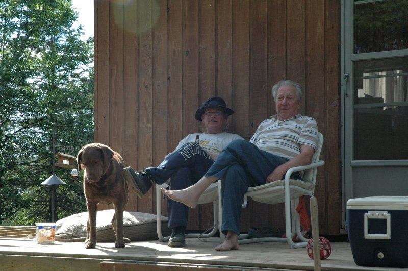 Cottage 2009 deck rebuilding Dad and Ken relaxing