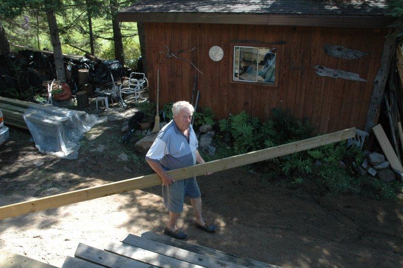 Cottage 2009 deck rebuilding Dad working