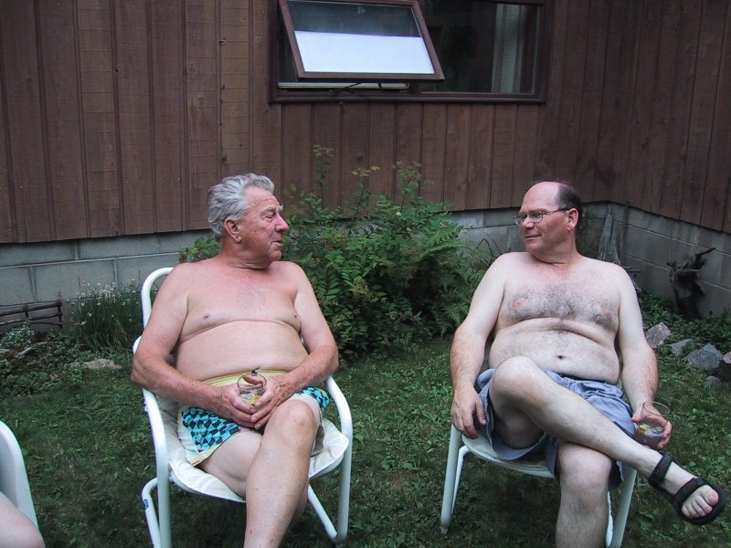 Dad and Ken relaxing on chairs at cottage 2002
