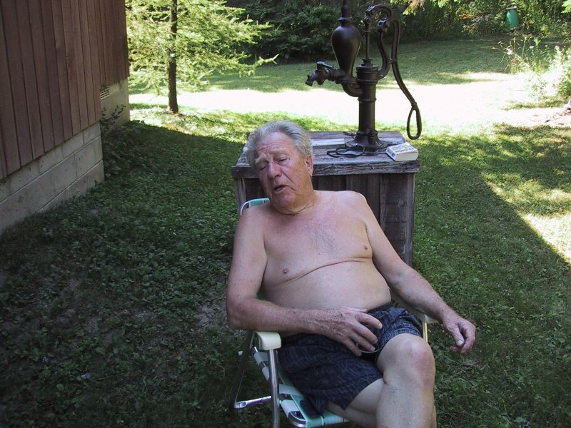 Dad ewlazing in chair at cottage 2002