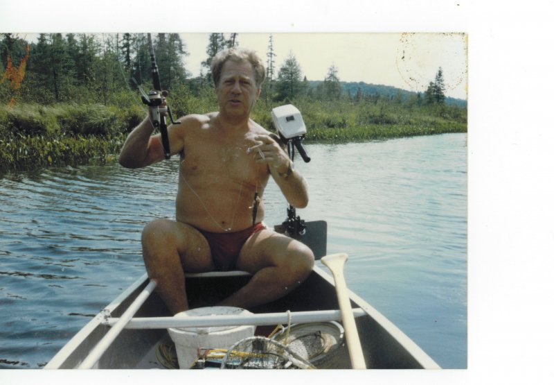 Dad's small fish in the canoe at cottage mid 80's