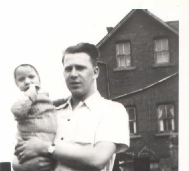 Ken Hermann holding baby Ken McCann- nmae taken from Uncle Ken