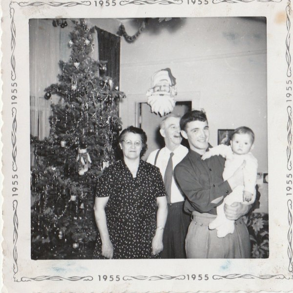 Dad in 1955 at Christmas with Nan & Pops