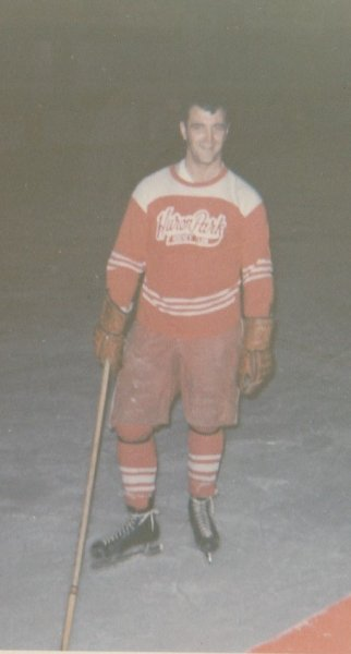 Dad in his hockey equipment