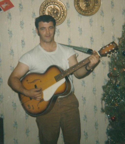 Dad with his guitar