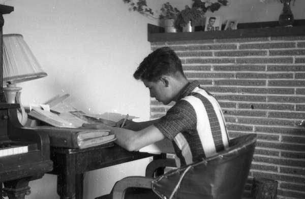 21-121_WalterMcC-doing-homework