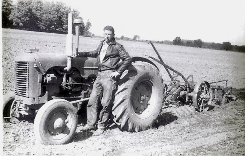 Ross farm, dad on tractor 1958_edited