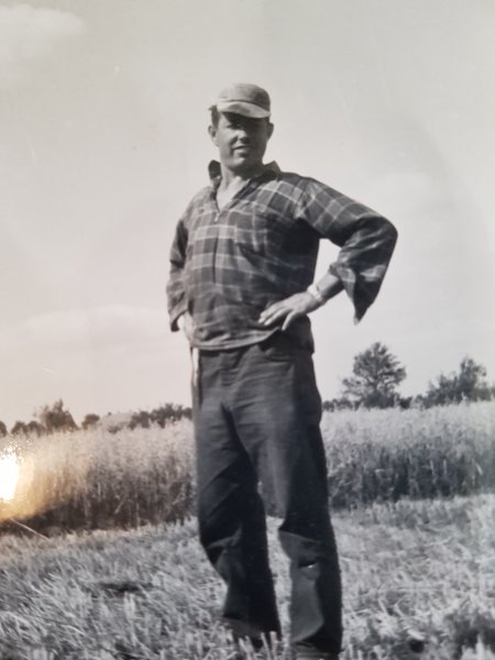 albert standing in field farmer