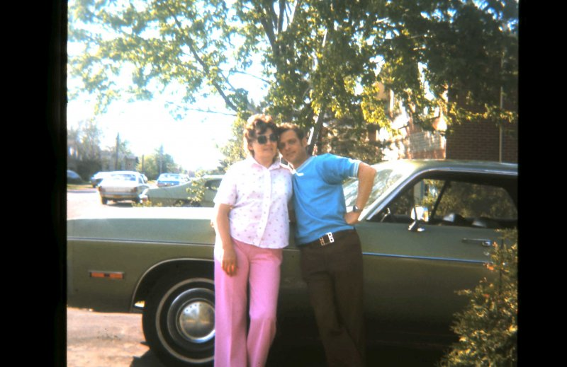 734 Loving couple with new car